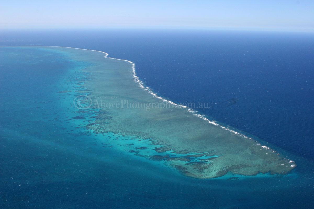 Aerial Photo Of Blue Barrier Vs The Ocean Above Photography